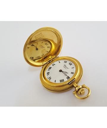 Złoty sekretnik CHOPARD z zegarkiem Geneve