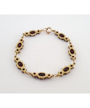 Złota bransoleta zdobiona granatami z I połowy XX wieku