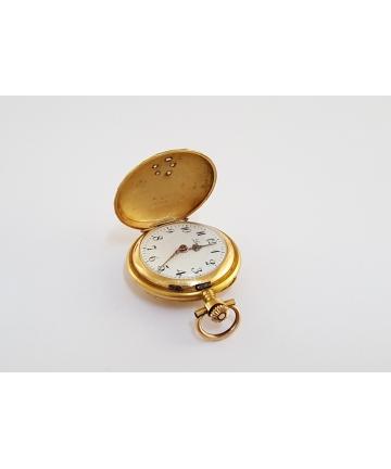 Złoty medalion z zegarkiem zdobiony diamentami z około 1900 roku
