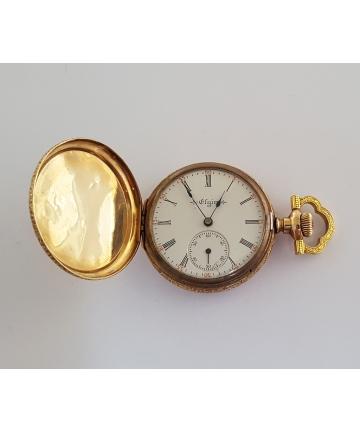 Złoty medalion z zegarkim...
