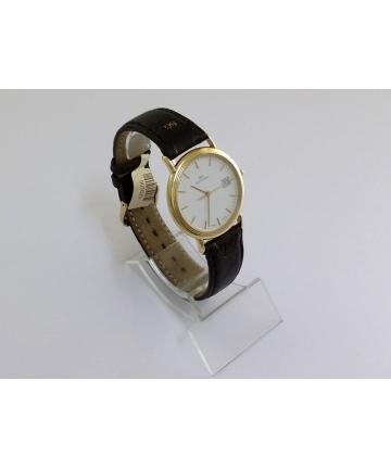 Złoty zegarek szwajcarskiej...